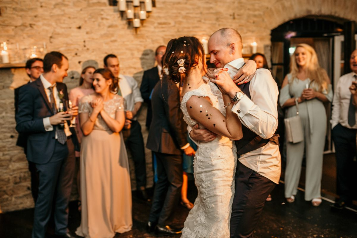 bride and groom with glitter on during the wedding party in the Merriscourt Barn Wedding venue by Cotswolds wedding photographer