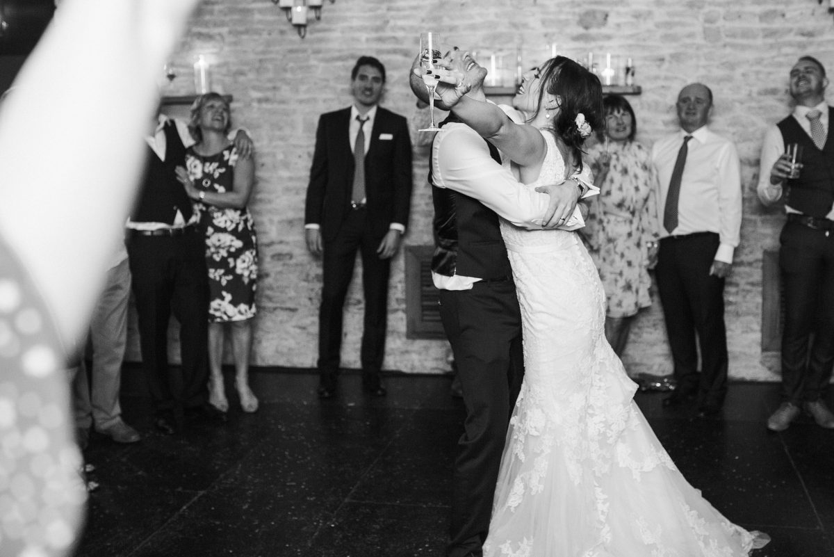 black and white image of bride and groom dancing at Merriscourt Barn Wedding in the evening