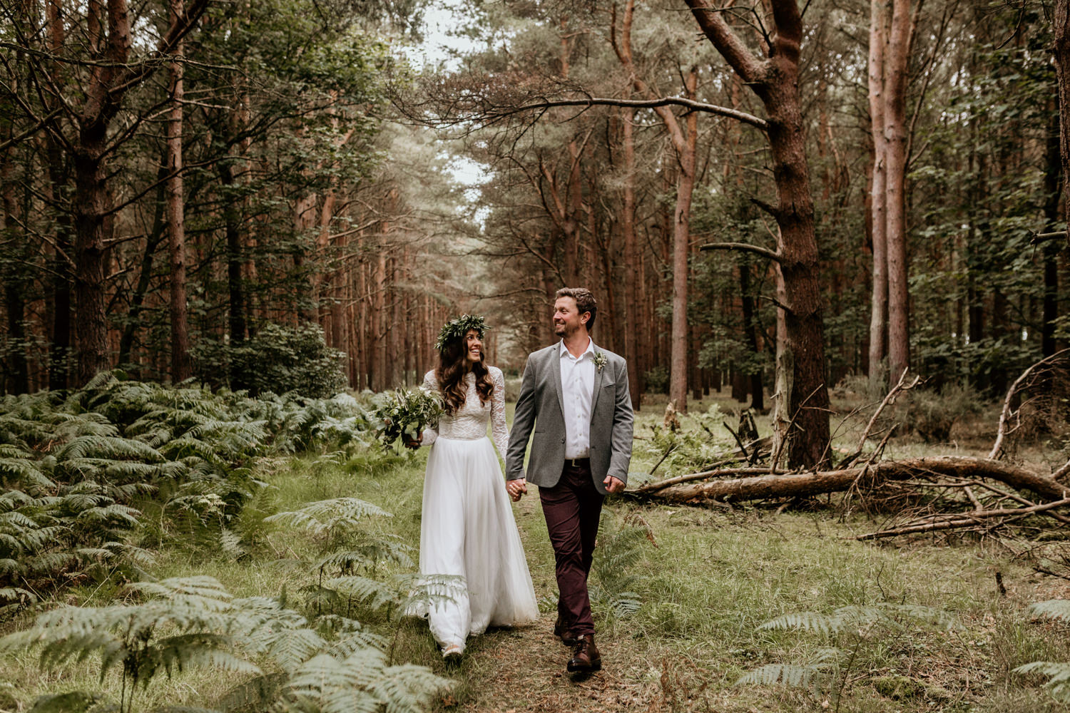 bride and groom walk during their forest wedding at Harvest Moon Holidays Scotland