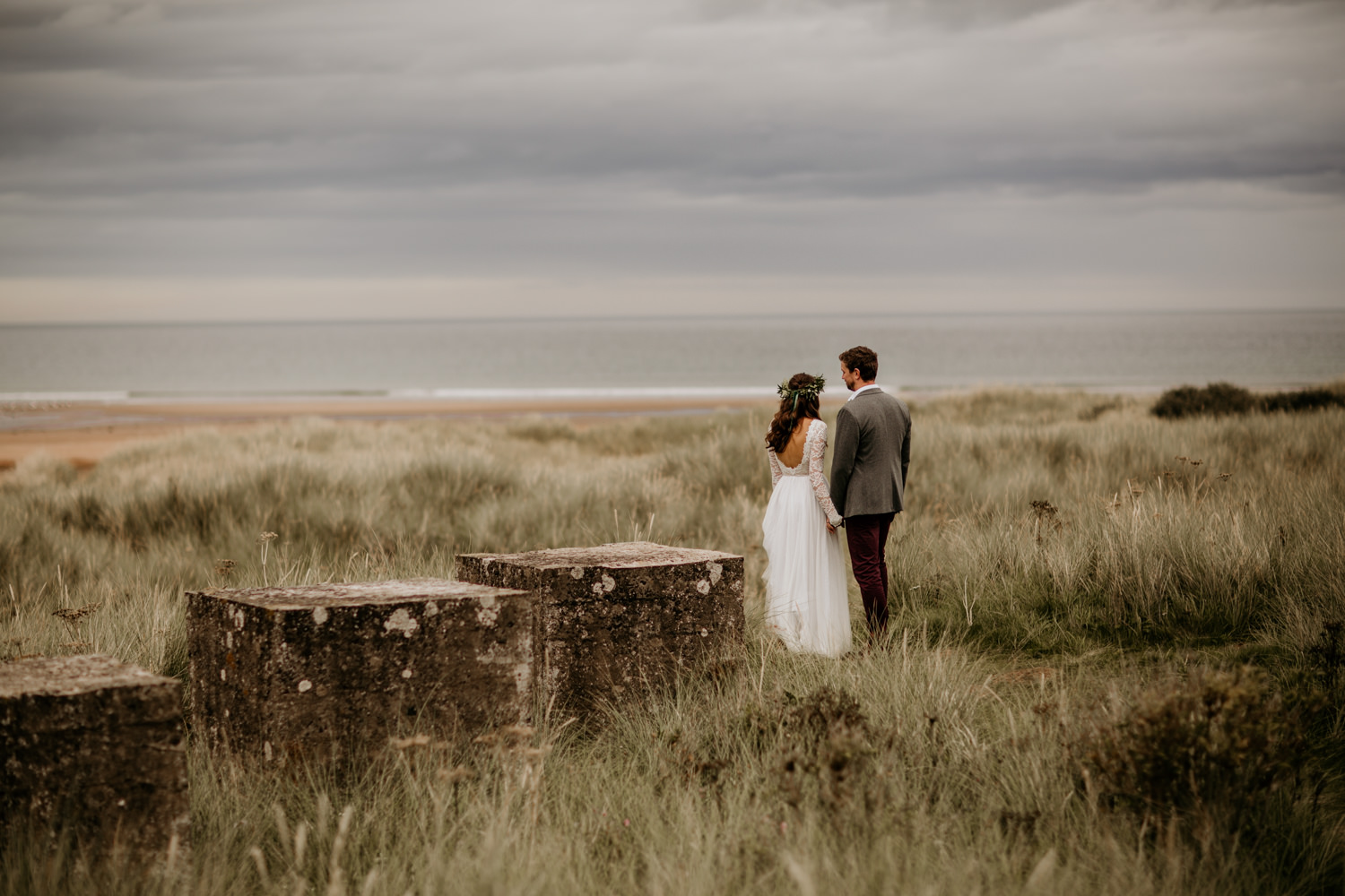 bride and groom overlooking the sea during their wedding portraits at Harvest Moon Holidays Scotland