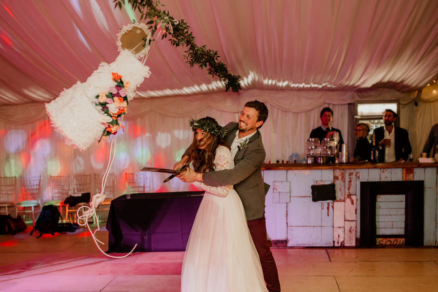 bride and groom kicking the confetti non-traditional wedding cake during their Scotland elopement at Harvest Moon