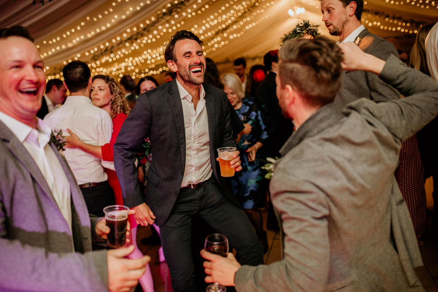 guests laughing and dancing during the wedding reception at Harvest Moon Wedding Scotland