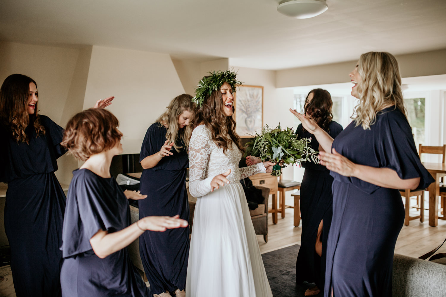 bride and bridesmaids dancing to Taylor Swift Shake it off before the wedding ceremony in Scotland