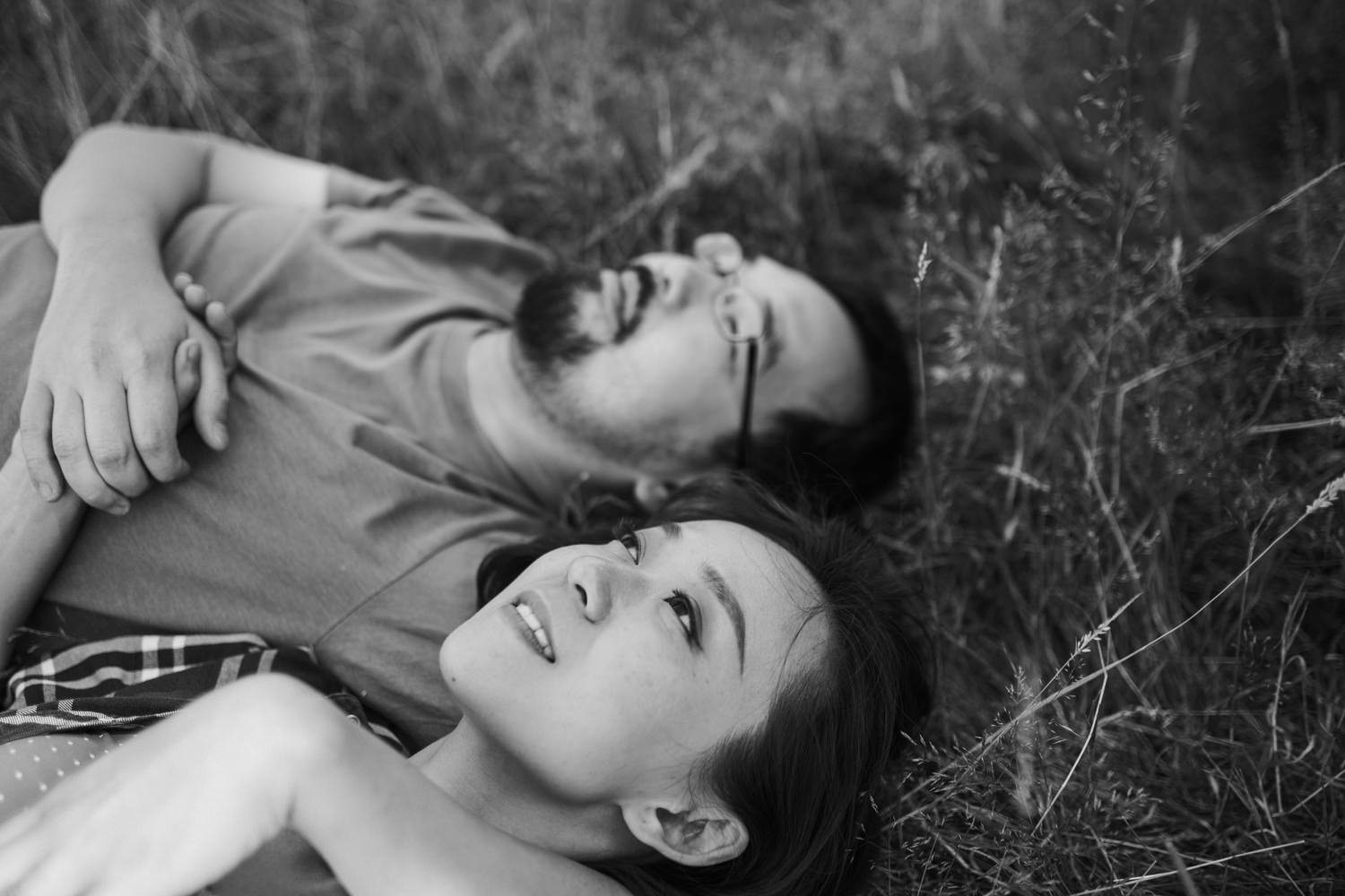 black and white photo of couple on grass at Richmond park during their engagement shoot