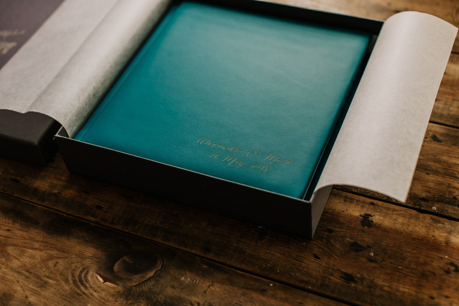 green leather wedding album in a presentation box