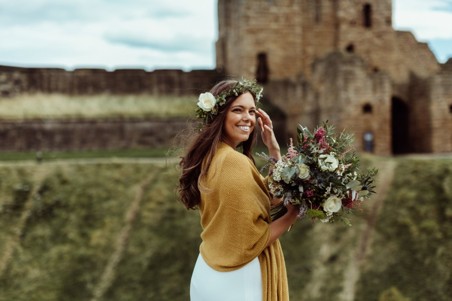 summery bohemian wedding flowers for a bride with a mustard scarf in Scotland