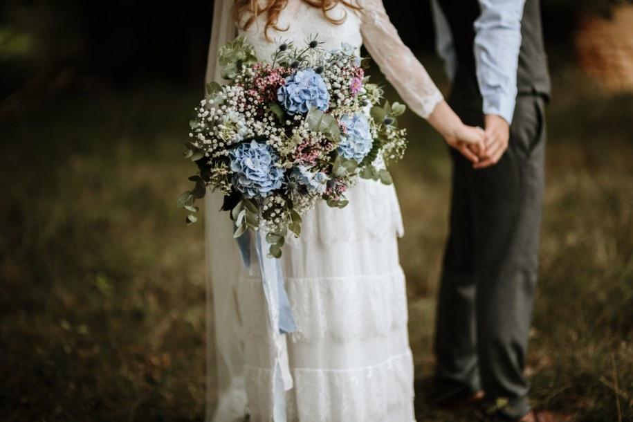 blue hydrangea wedding bouquet for a bohemian bride