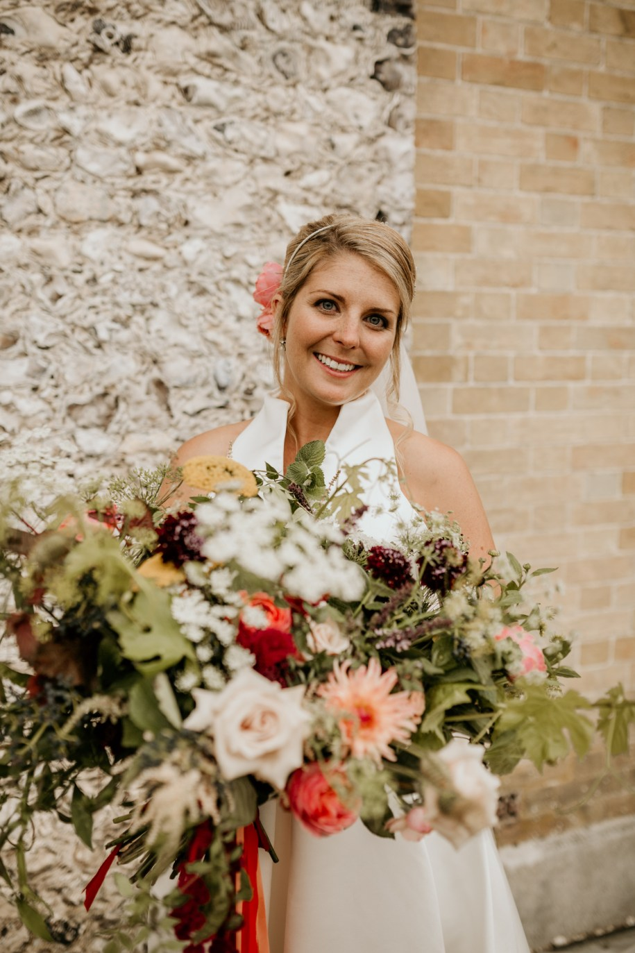 classical yet full of life bride holding her giant bohemian wedding bouquet