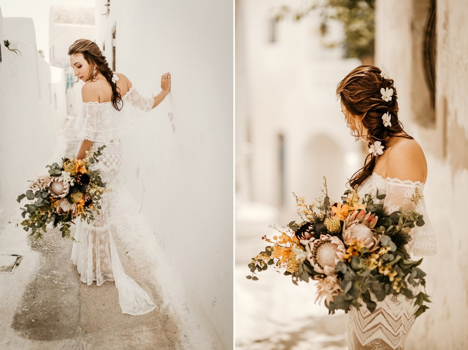 massive bohemian wedding bouquet with king proteas flowers on the streets in Santorini