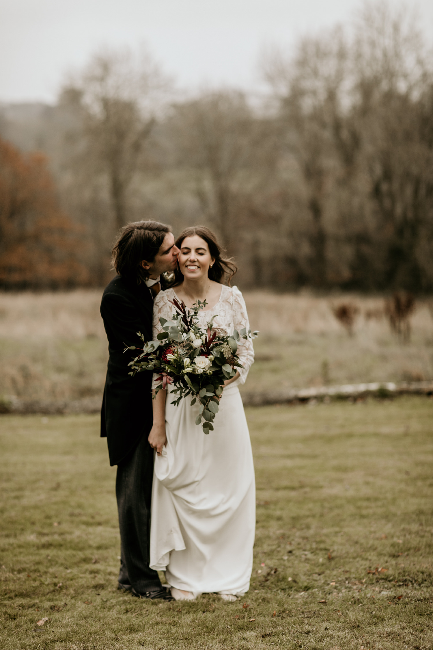 Stroud wedding photographer , bride and groom kissing during a wedding portrait