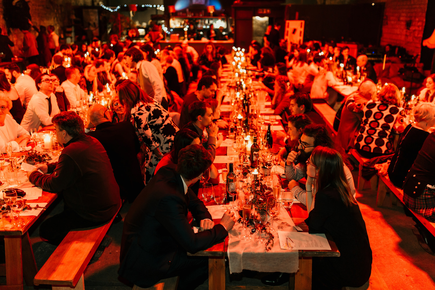 guests during the wedding reception at The goods shed sitting at long tables