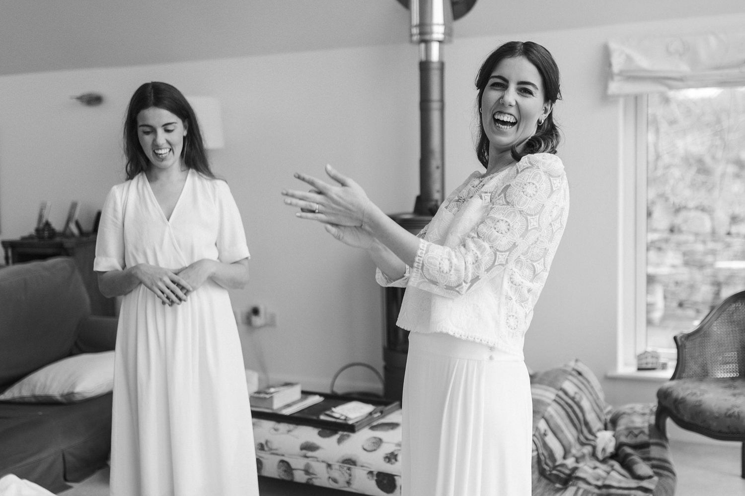 bride getting ready in the morning with her twin sister for her Stroud wedding Cotswolds