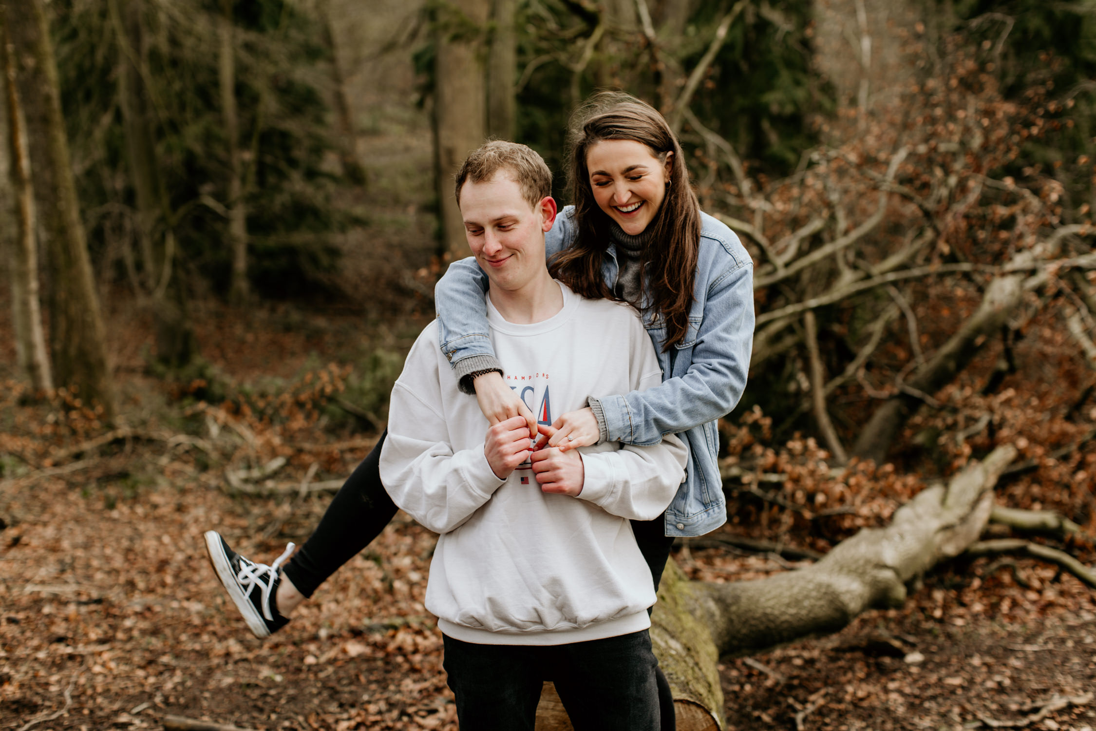 fun couple photo shoot in a forest at Broadway Tower in the Cotswolds