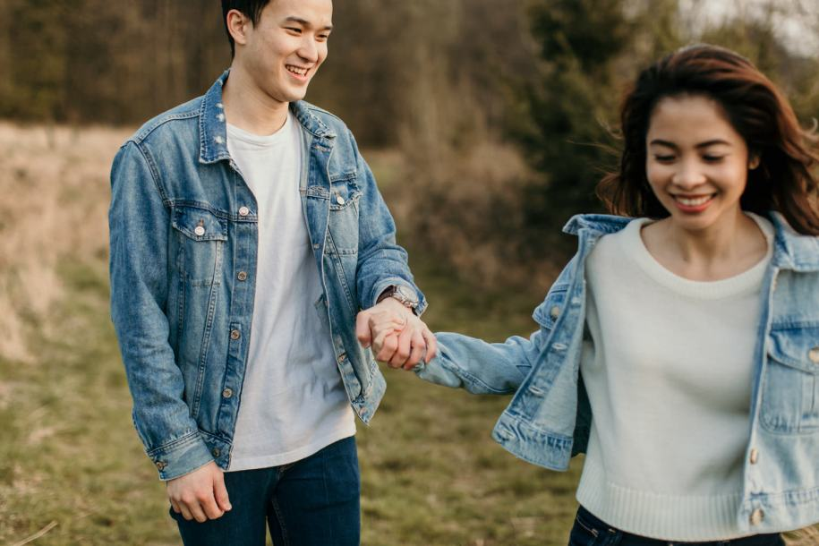 couple wearing denim jackets for their cotswolds engagement portraits