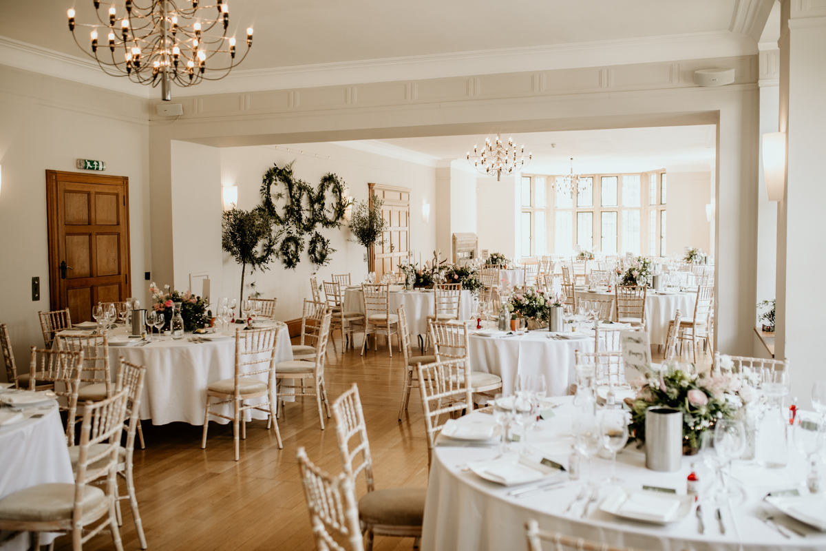wedding reception with round tables at Coombe Lodge Blagdon