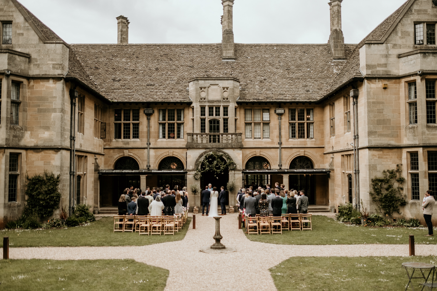 outdoor wedding ceremony in the gardens of Coombe Lodge Blagdon wedding venue