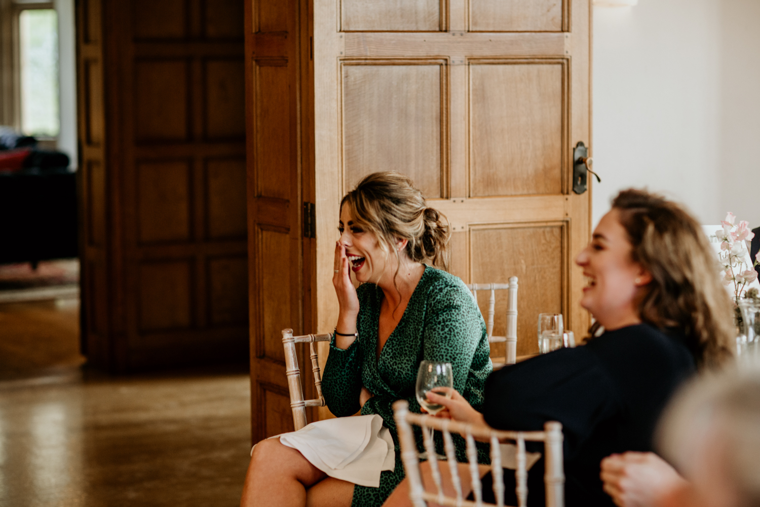 guests laughing during speeches at Coombe Lodge Blagdon wedding venue