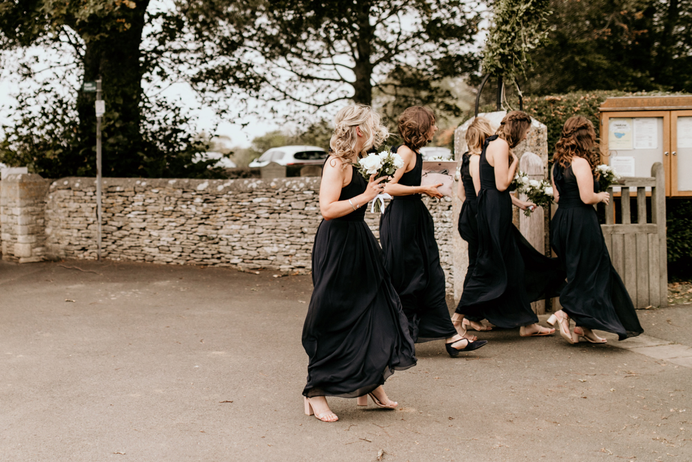 bridesmaids walk to church for a Poulton wedding ceremony