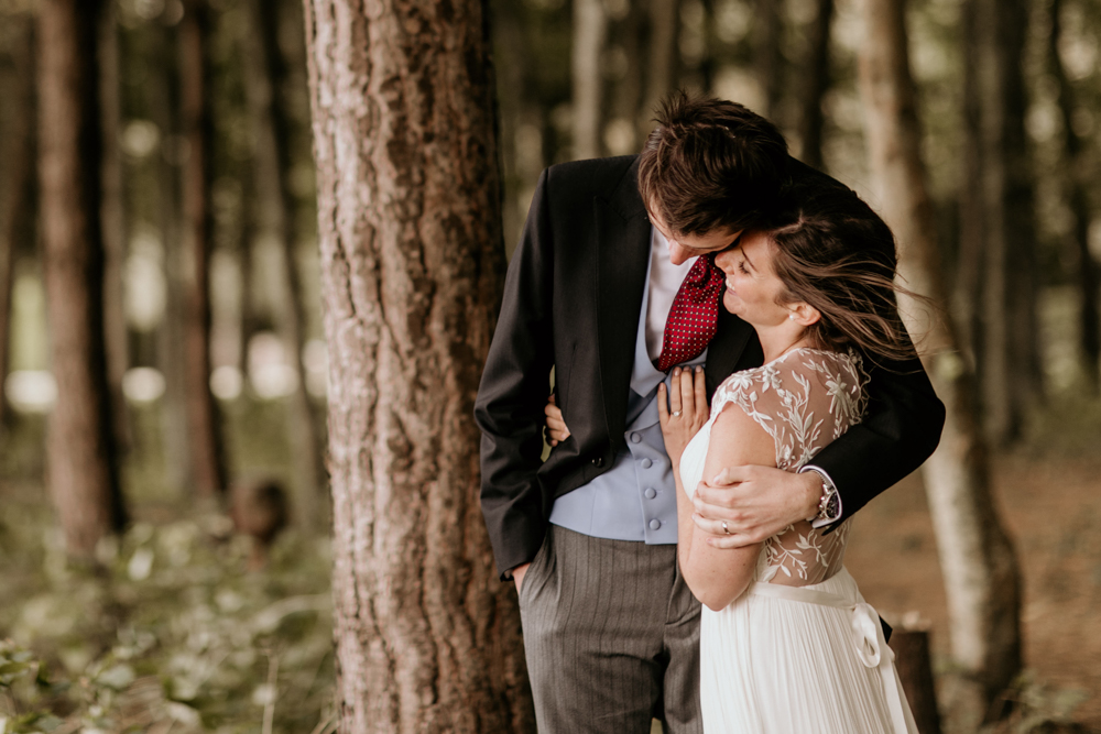 bride and groom hug during their portrait session in Poulton