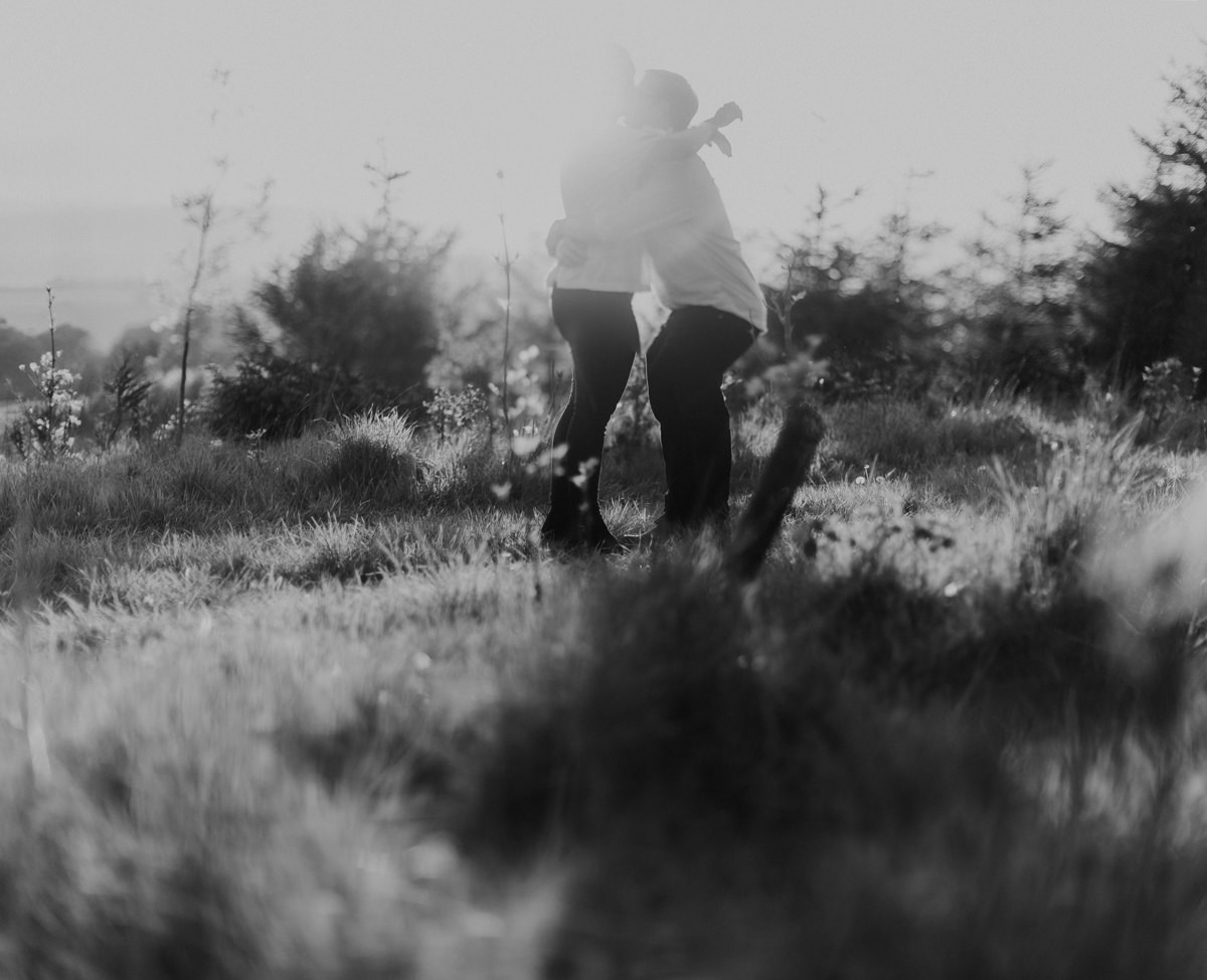 black and white image during the golden hour at broadway tower for a cotswolds countryside engagement session