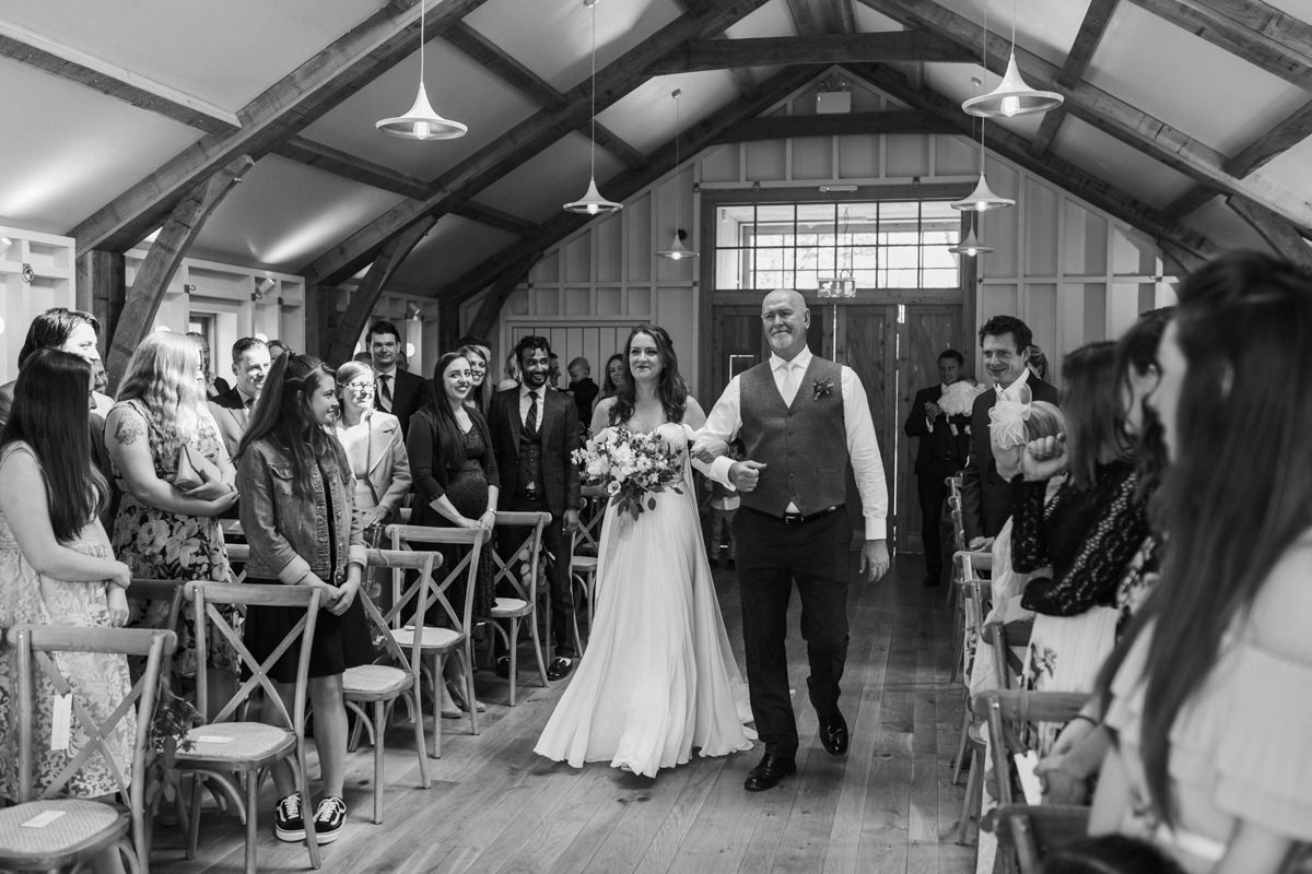 bride and father coming down the aisle at hyde house wedding barn, the grange