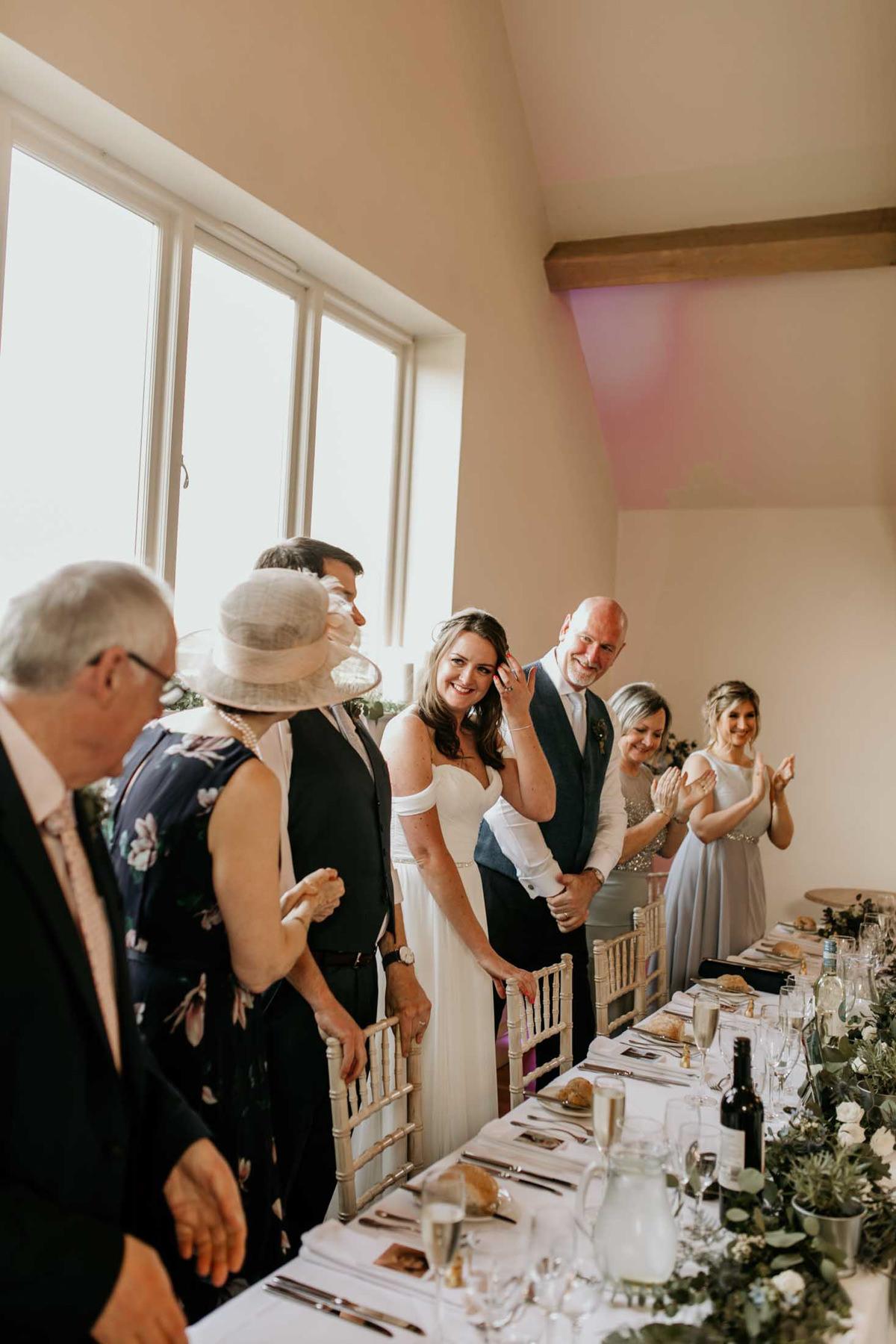 bride entering the wedding reception at hyde house wedding venue