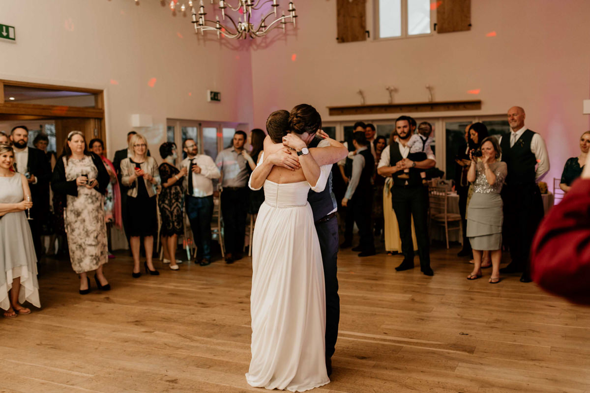 bride and groom embrace at hyde house wedding venue