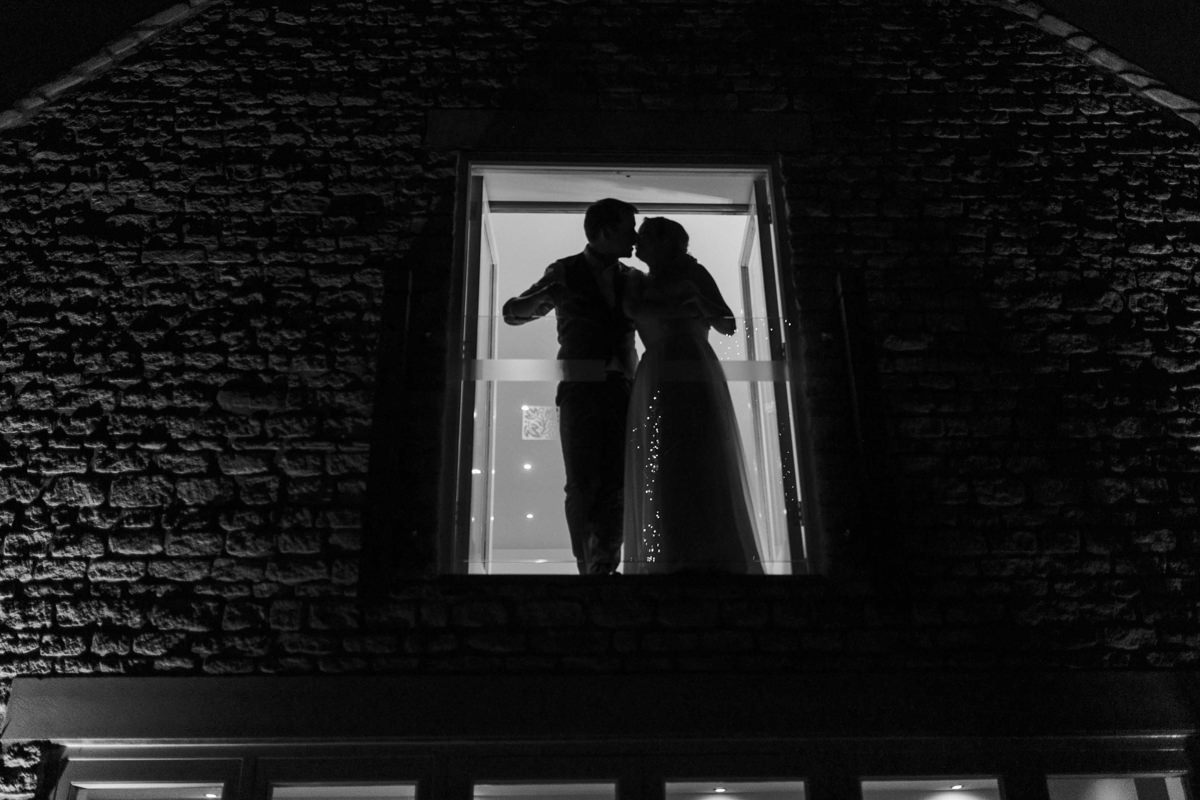 bride and groom kiss at hyde house wedding venue