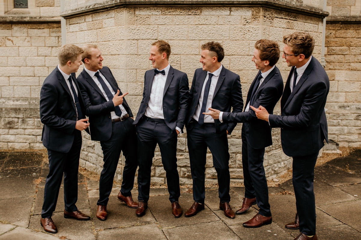 groom and his groomsmen getting ready for the church ceremony in Gloucestershire