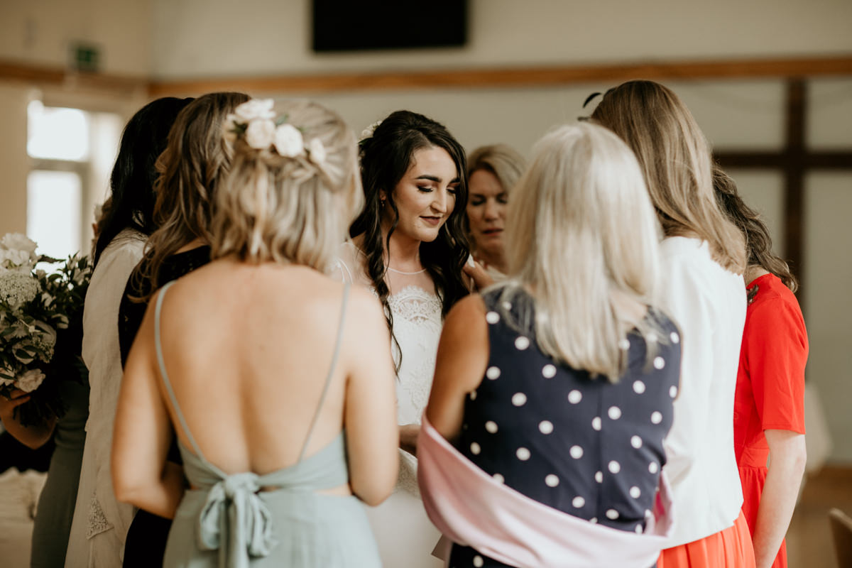 bride and bridesmaids praying before the wedding ceremony in church