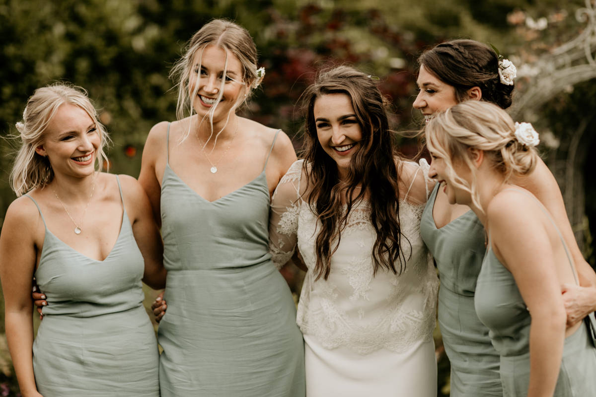 bride and bridesmaids during the group shots at Priors Court Barn