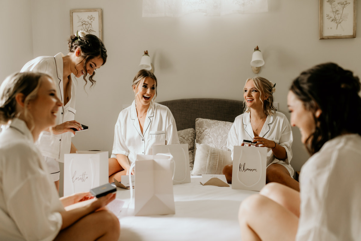 bridesmaids receive gift from bride