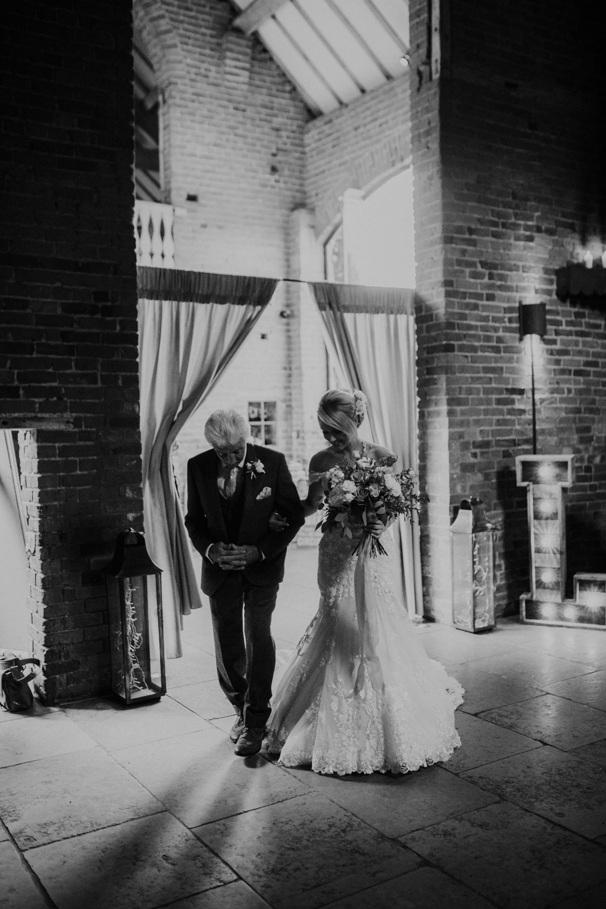 bride and father walking down the aisle at Shustoke Barn