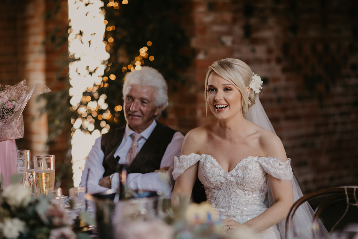 father and bride at table during speeches for a Shustoke Barn wedding