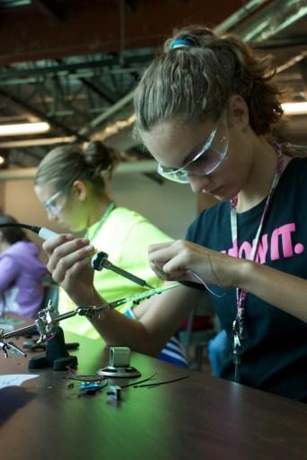 girls soldering wires