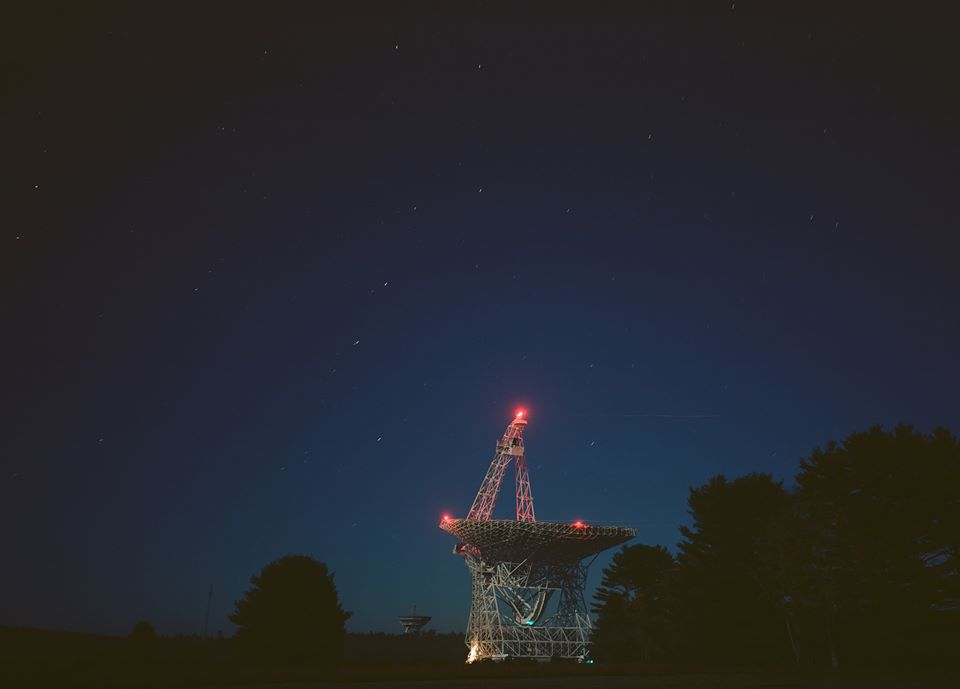The Green Bank Telescope with a dark sky of stars.