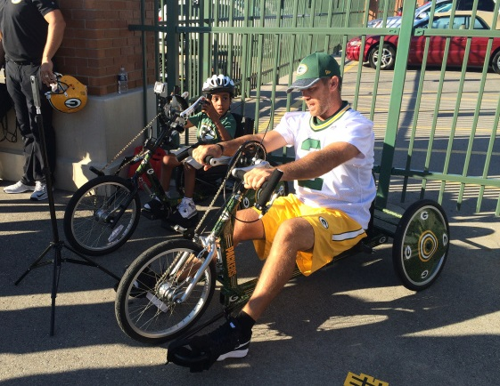 mason-crosby-riding-on-adaptive-bike
