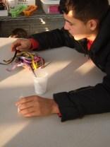 Jordan selects a ribbon for his sachet.