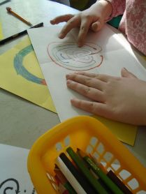 One student practices tracing her labyrinth.