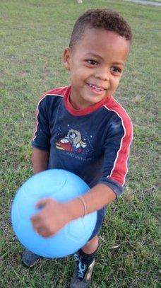 Happy recipient of Berkeley-made indestructible soccer ball