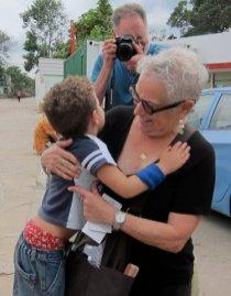 Luigi gives delegation member Carole Norris a big hug