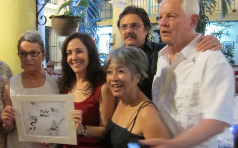 "Mariella receives Khalil Bendib's ""Play Ball"" cartoon from Loni and Tom"