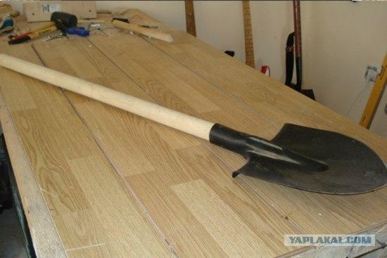 anonymous artist converts shovel into a guitar 1