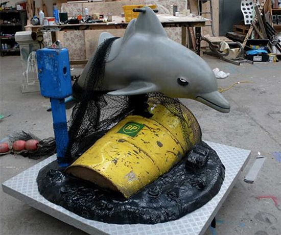banksy kiddie ride dolphin bp oil photo