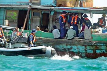 illegal fishing boat being seized