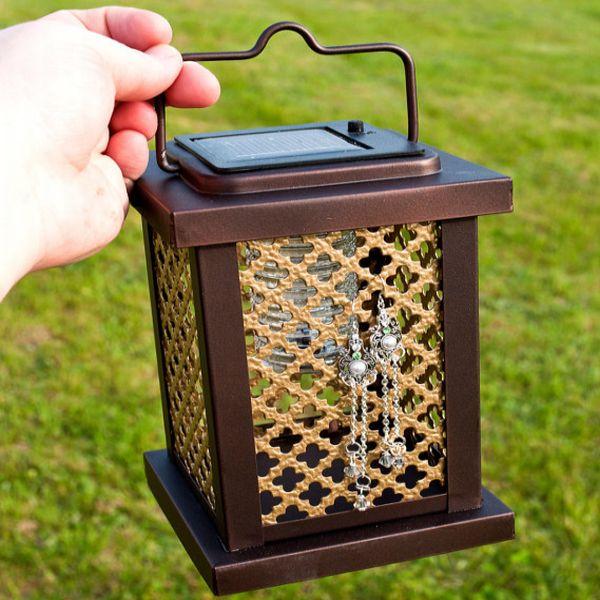 Solar powered LED earring holder