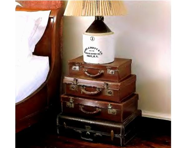 Unique pile up suitcase table design