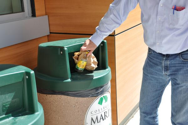 Throwing plastic bags into recycling bins