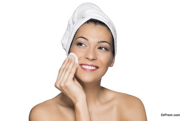 Beauty Portrait Of Beautiful Smiling Woman Washes Her Face With Towel On Head Isolated On White Background