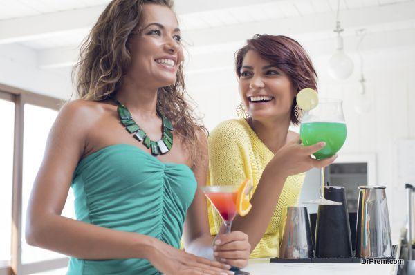 Two Beautiful Girl Enjoying Cocktail At Bar